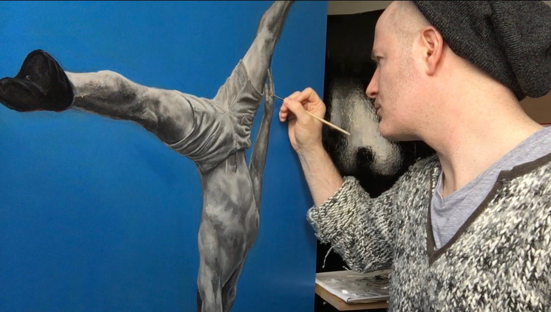 A photograph of David Brodie painting his 'Glasgow Gymnast' oil painting.